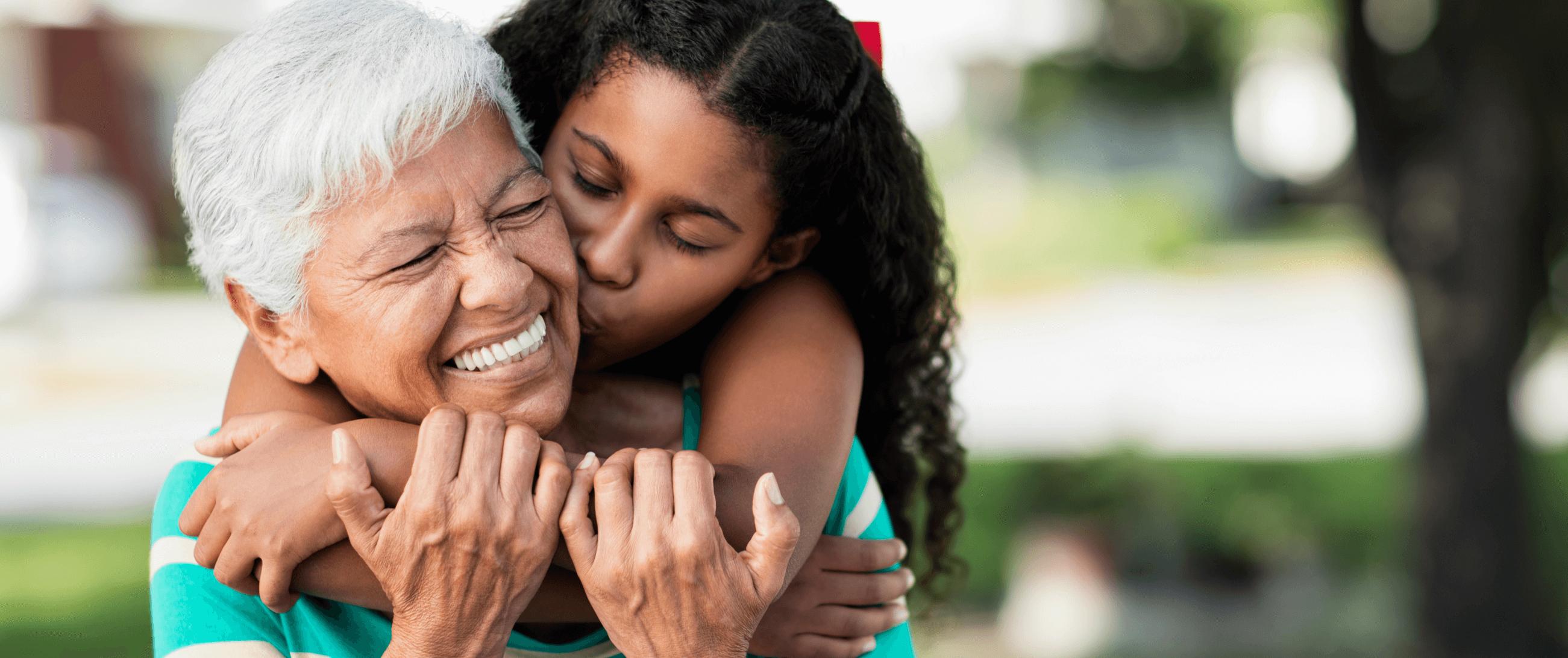 granddaughter hugging her grandma