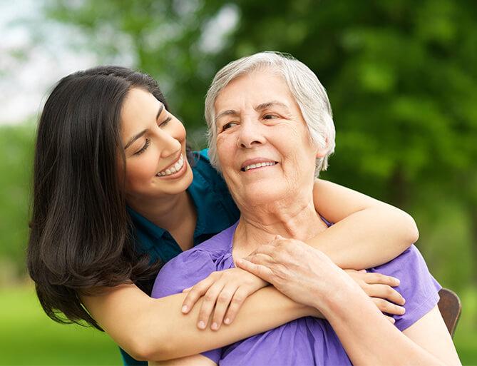 two woman hugging